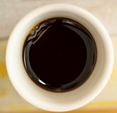 Soy sauce in a small white bowl