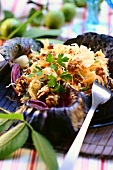 White cabbage salad with walnuts and pineapple