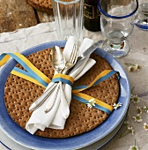 A Swedish place setting with round crispbread
