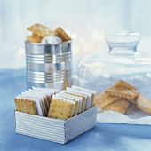 Several Parmesan biscuits in containers