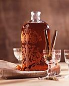Saffron liqueur in a bottle with glasses