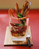 Razor shell salad with bacon and white beans in glass