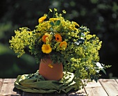 Marigolds with lady's mantle and golden rod