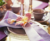 Fabric flower with napkin on a plate