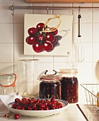 Plate of cherries and two jars of cherry compote