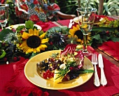 Plate of salad on a table with garland of flowers