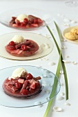 Rhubarb compote with amarettini on three glass plates