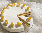 Cream cake with chocolate cream filling on cake stand