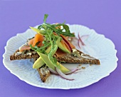 Avocado, rocket & smoked salmon on slices of wholemeal bread