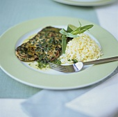 Veal escalope with tarragon butter and rice