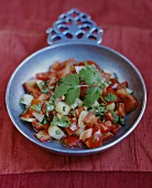 Tomato and onion salad with coriander