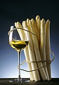 A bundle of fresh white asparagus with wine