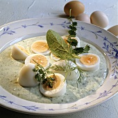 Boiled eggs in green sauce
