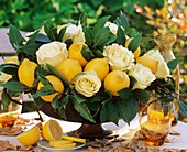 Arrangement of lemons, 'Hollywood' roses and bay leaves