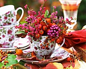 Arrangement of rose hips, beautyberry, heather