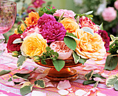 Roses, sage and parsley in a glass bowl