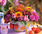 Dahlias, roses, St. John's wort berries, golden rod & Physalis