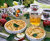 Two apple tarts and apple jelly with rosemary