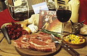 Raw beef steaks with decorative items (Argentina)