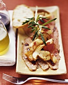 Boiled fillet of veal with ceps and peaches