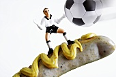 A goal keeper on a sausage with mustard