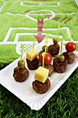 Meatball kebabs in front of a football bath towel