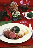 Saddle of lamb with polenta cakes, spinach and garlic