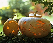 Two pumpkins artistically decorated with star & witch motifs