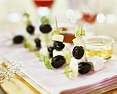 Olives, feta and melon on cocktail sticks