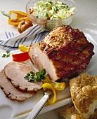 Glazed ham with salad and flatbread