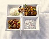 Pork and pepper curry with rice and yoghurt sauce