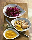 Duck breast with orange sauce and red cabbage salad
