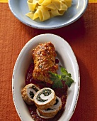 Turkey roll stuffed with spinach in spicy tomato sauce