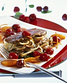 Ostrich fillets with sour cherry sauce and linguine