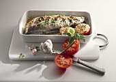 Baked fish with herbs and tomatoes