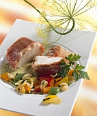 Monkfish medallions wrapped in ham with peppers