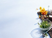Wild herbs, nasturtium flowers and shallots