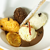 Several scoops of chocolate and coconut ice cream