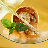 Shrimps with grapefruit segments in a grapefruit half