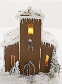 A gingerbread house, lit from inside