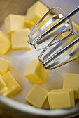 Baking ingredients: sugar and butter with two beaters