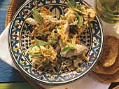 Rice and poultry salad with mint, pine nuts and currants