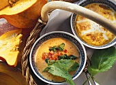 Pumpkin soup with sorrel & cream soup with toasted cheese