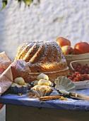 Still life with gugelhupf, baking utensils & ingredients