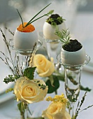 Eggs in their shells filled with caviare on candlesticks