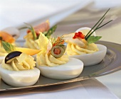 Stuffed eggs with various garnishes on tray