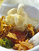 Fried vegetable crisps & prawn crackers with spicy sauce