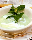 Pea soup with sprig of mint