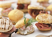 Several filled party rolls with shrimps, roast beef