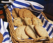 Assorted round cookies in straw basket on boat
